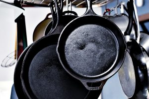 Cast Iron Griddles Hanging Up - Featured Image Best Cast Iron Griddles