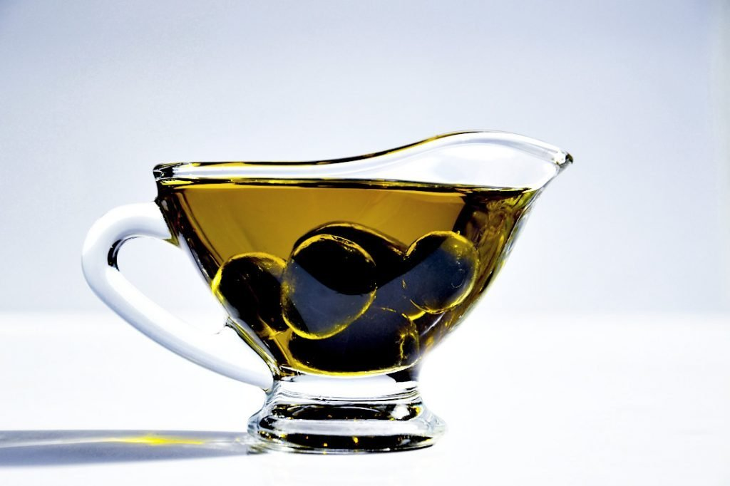 Olives in oil in a pouring dish