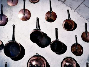 Copper pans on wall