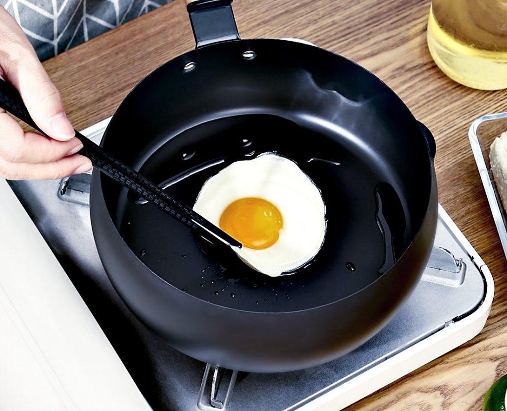 Nonstick pan frying an egg