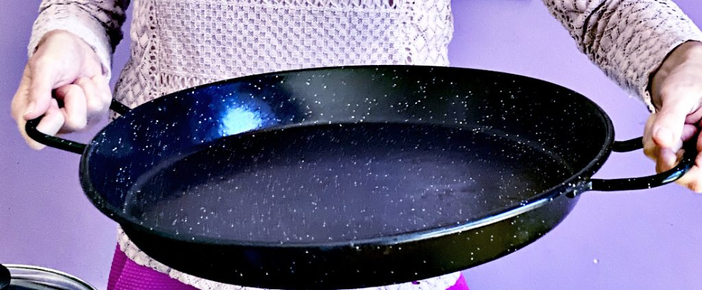 Enameled steel paella pan.  Black surface with white spots - looks like the sky at night.