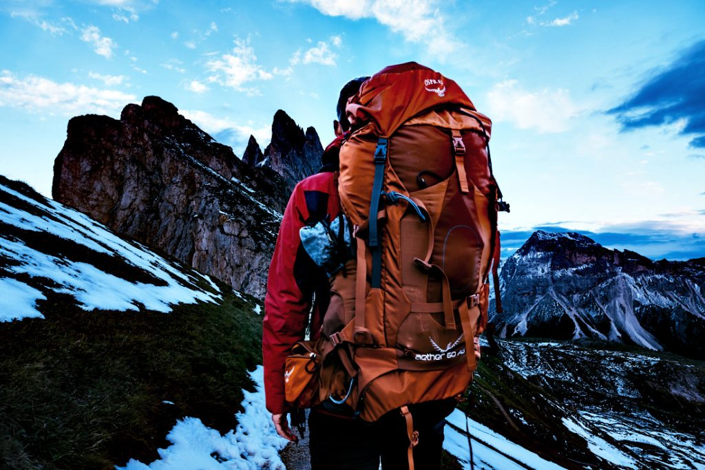 A person backpacking in the mountains