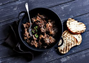 Easy peri-peri chicken livers in a cast iron pot - best cast iron pots featured image.