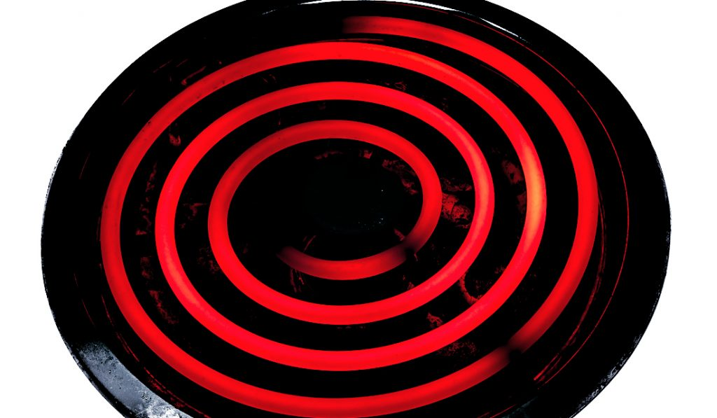 Glowing electric stove burner head spiral.