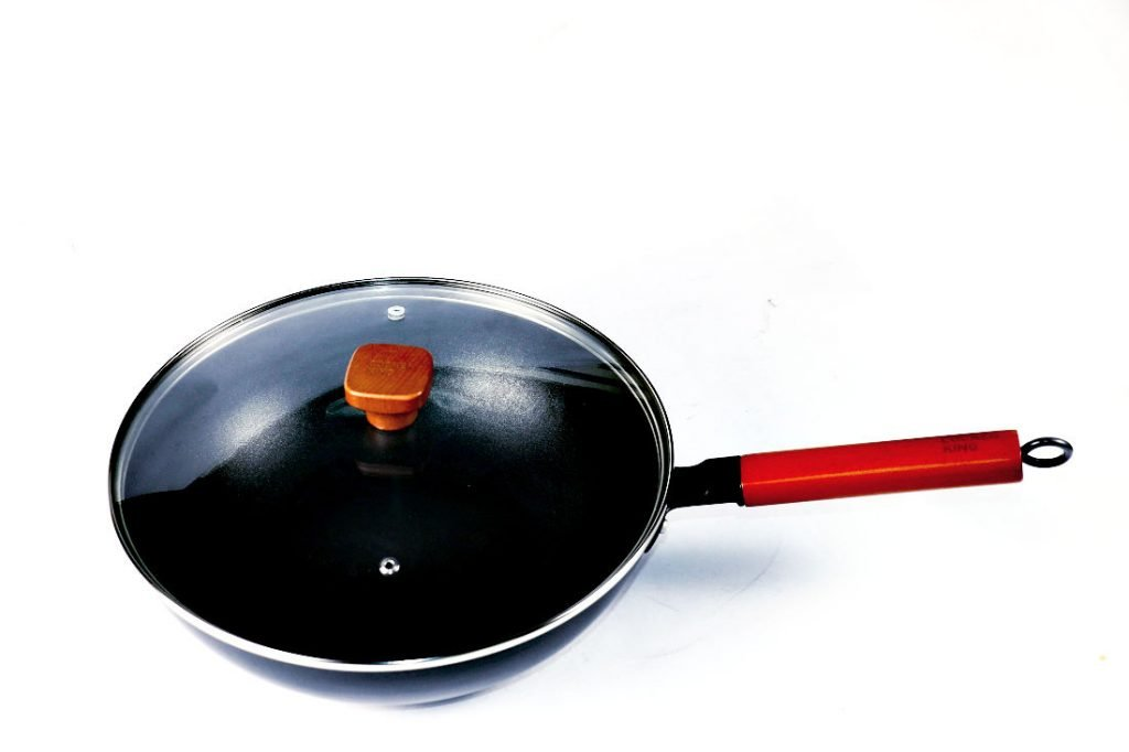 A non stick sauté pan with a lid.  The lid has two vents.