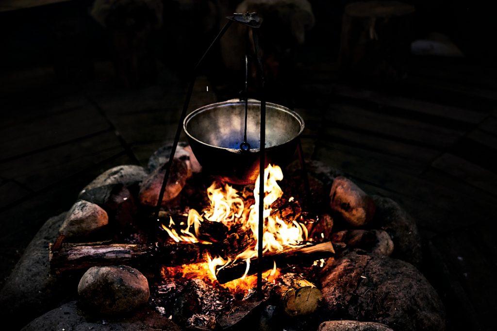 A pot cooking over a campfire