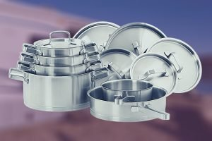 Stainless Steel Nested Cookware with an RV in the background - Best RV Cookware