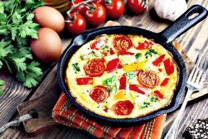 Frittata served in a cast iron pan - Best Pan For Eggs