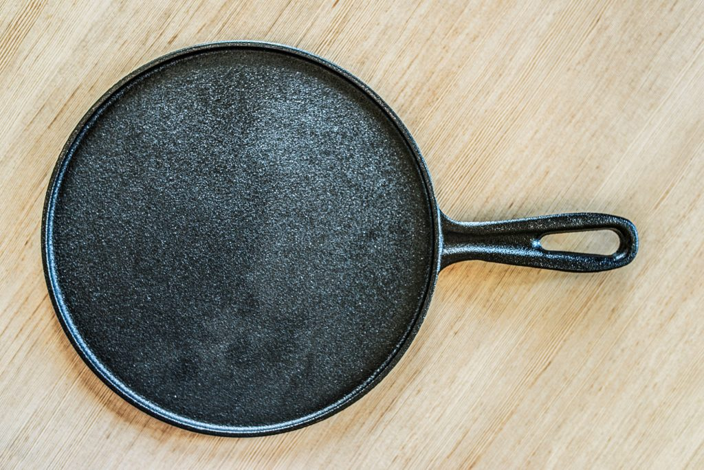 Cast iron griddle pan for cooking pancakes.