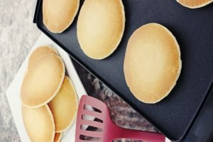 Preparing fresh pancakes on the best double burner griddle.