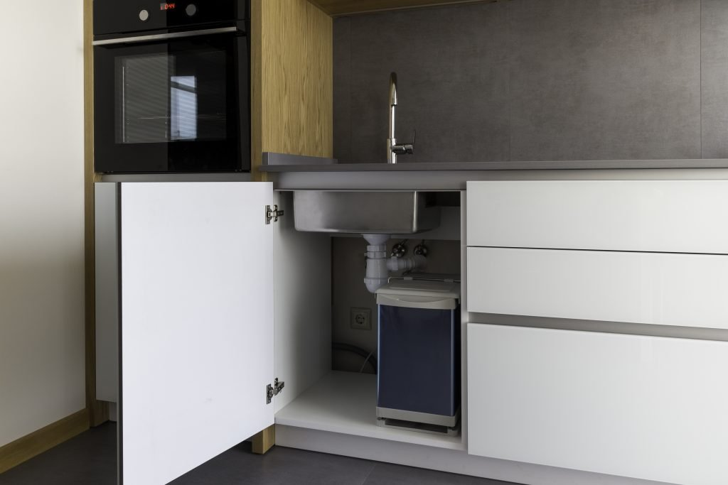 A Tidy Space with Garbage Disposal under the Kitchen Sink